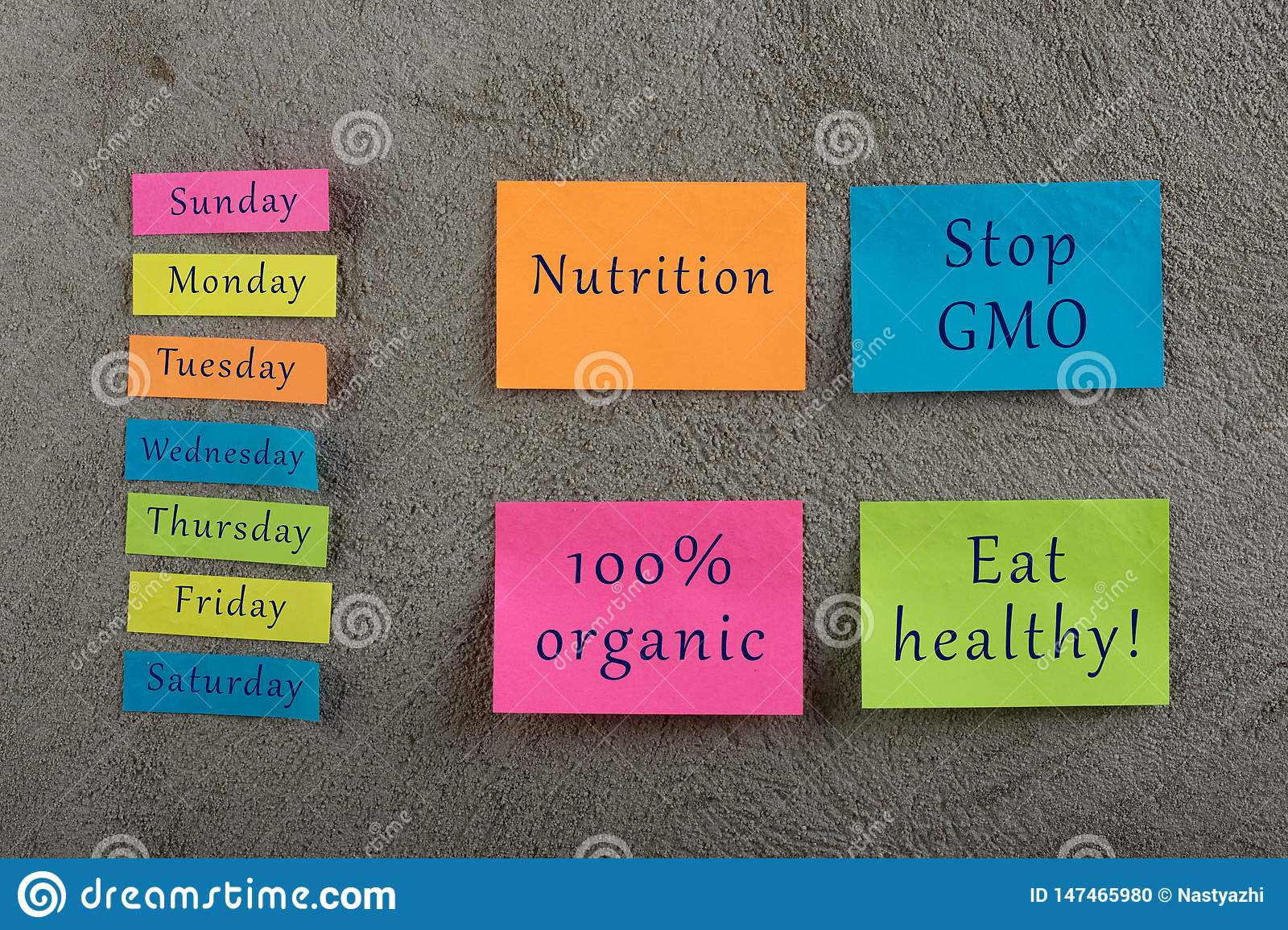 Diet plan concept - Many colorful sticky note with words nutrition, eat healthy, stop gmo, 100 percent organic and days of week