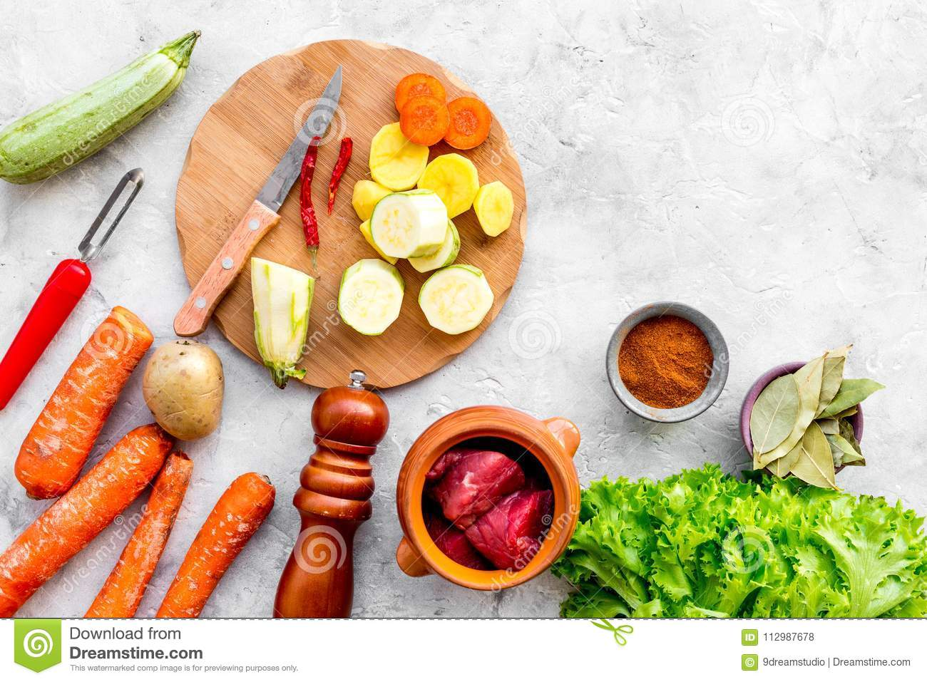 Diet vegetarian vegan food. Ratatouille or vegetable ragout. Stone table background top view space for text