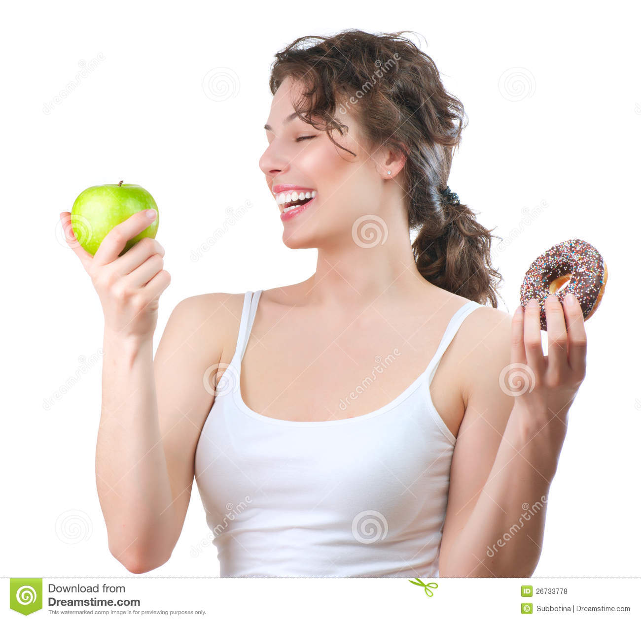 Diet. Young Woman choosing between Fruit and Donut
