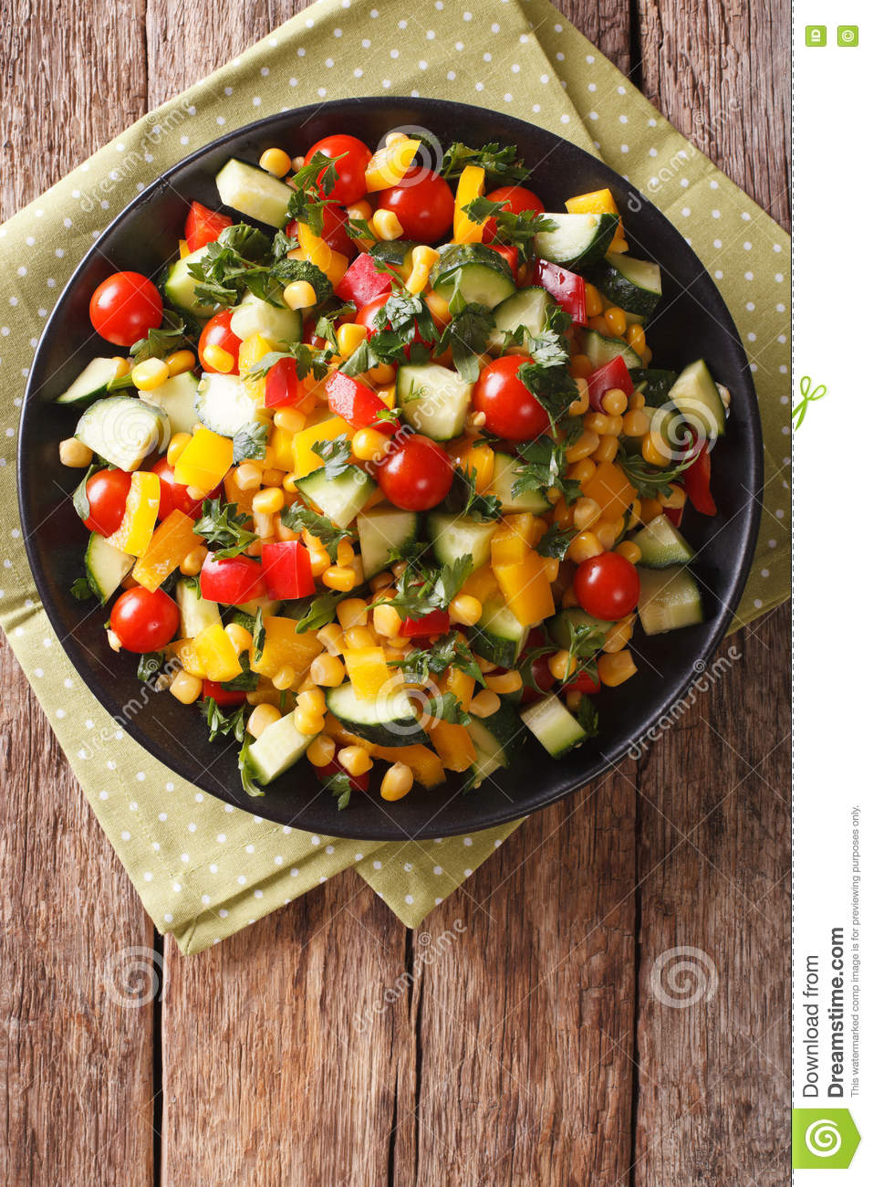 Dietary salad of corn, tomatoes, cucumbers and pepper. vertical