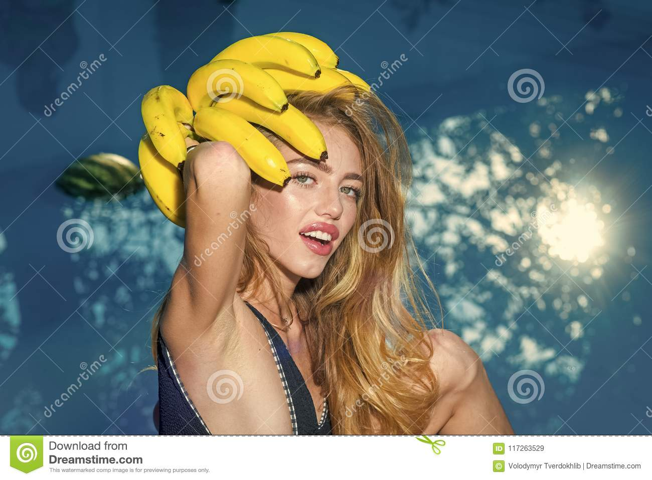Dieting and healthy organic food, vegetarian. Vitamin in banana at girl near water. Woman relax in spa luxury swimming