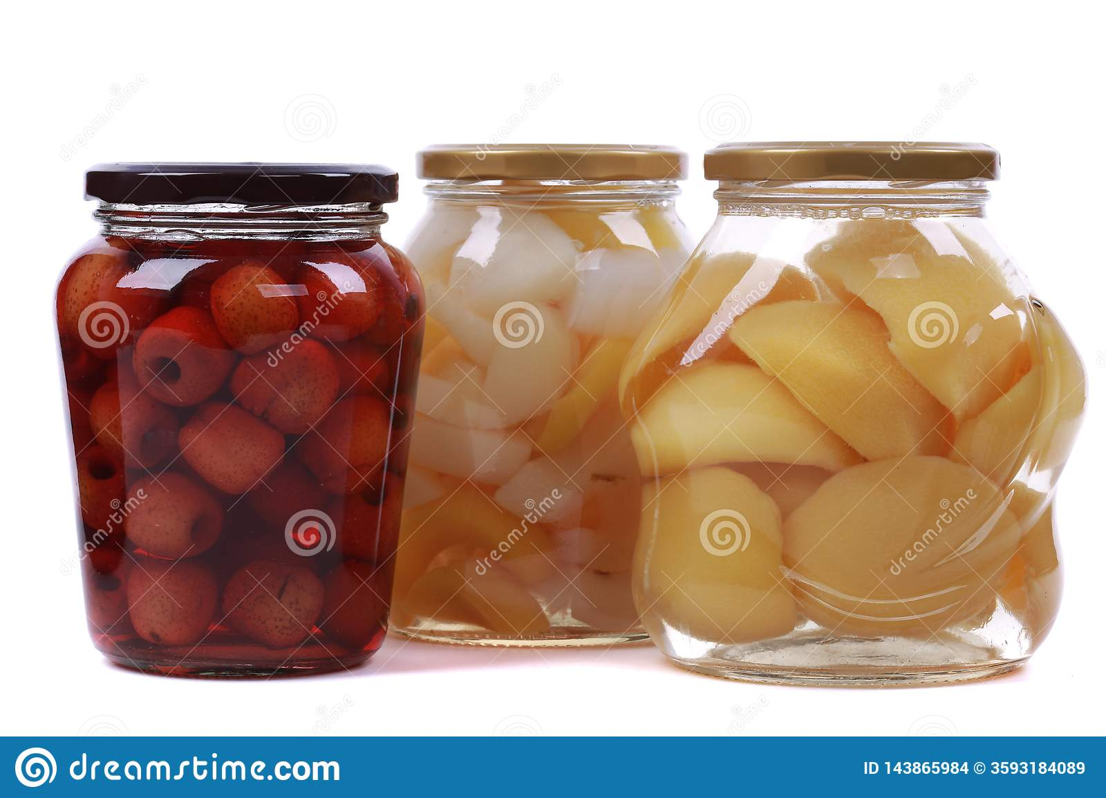 Different canned fruits in glass bottles