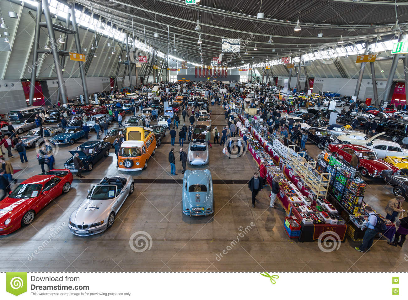 different cars and bikes in the exhibition hall. editorial photo