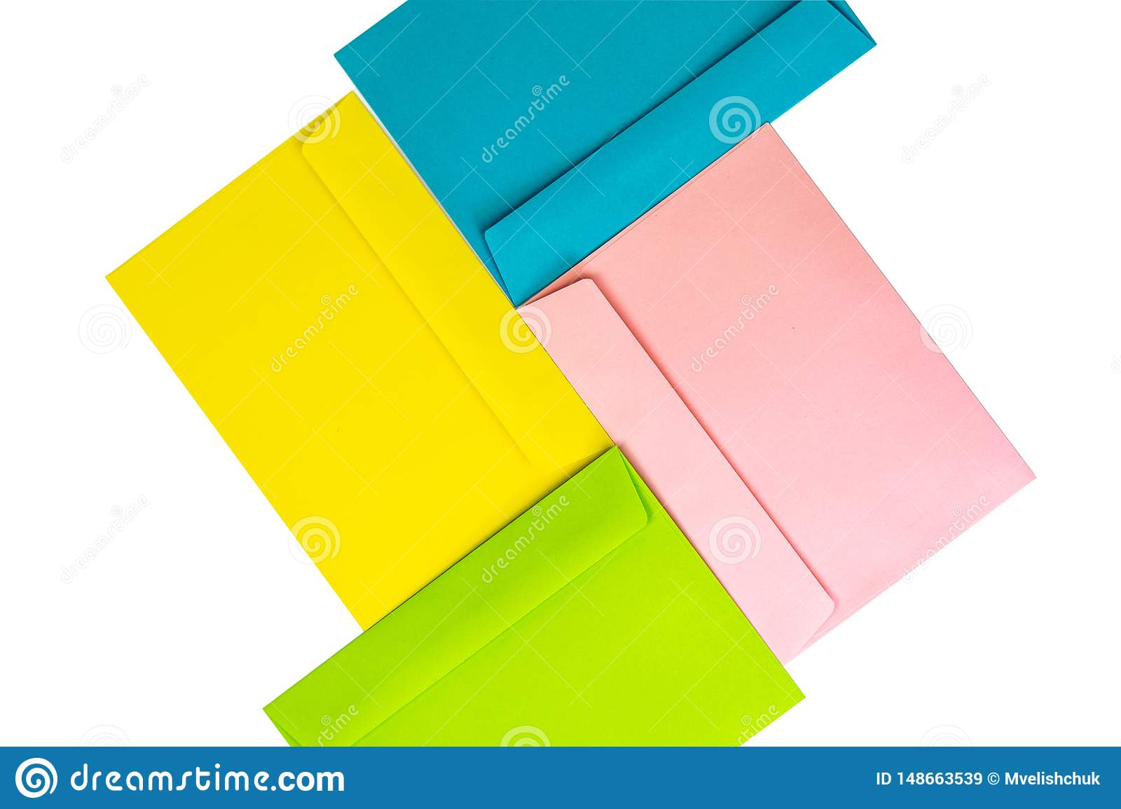 Different colored envelopes on the table. Multi colored envelopes and letters