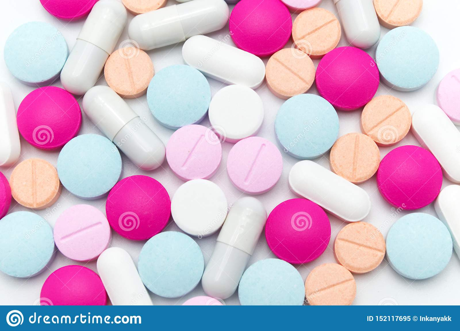 Different colorful pills or supplements for the treatment and health care.