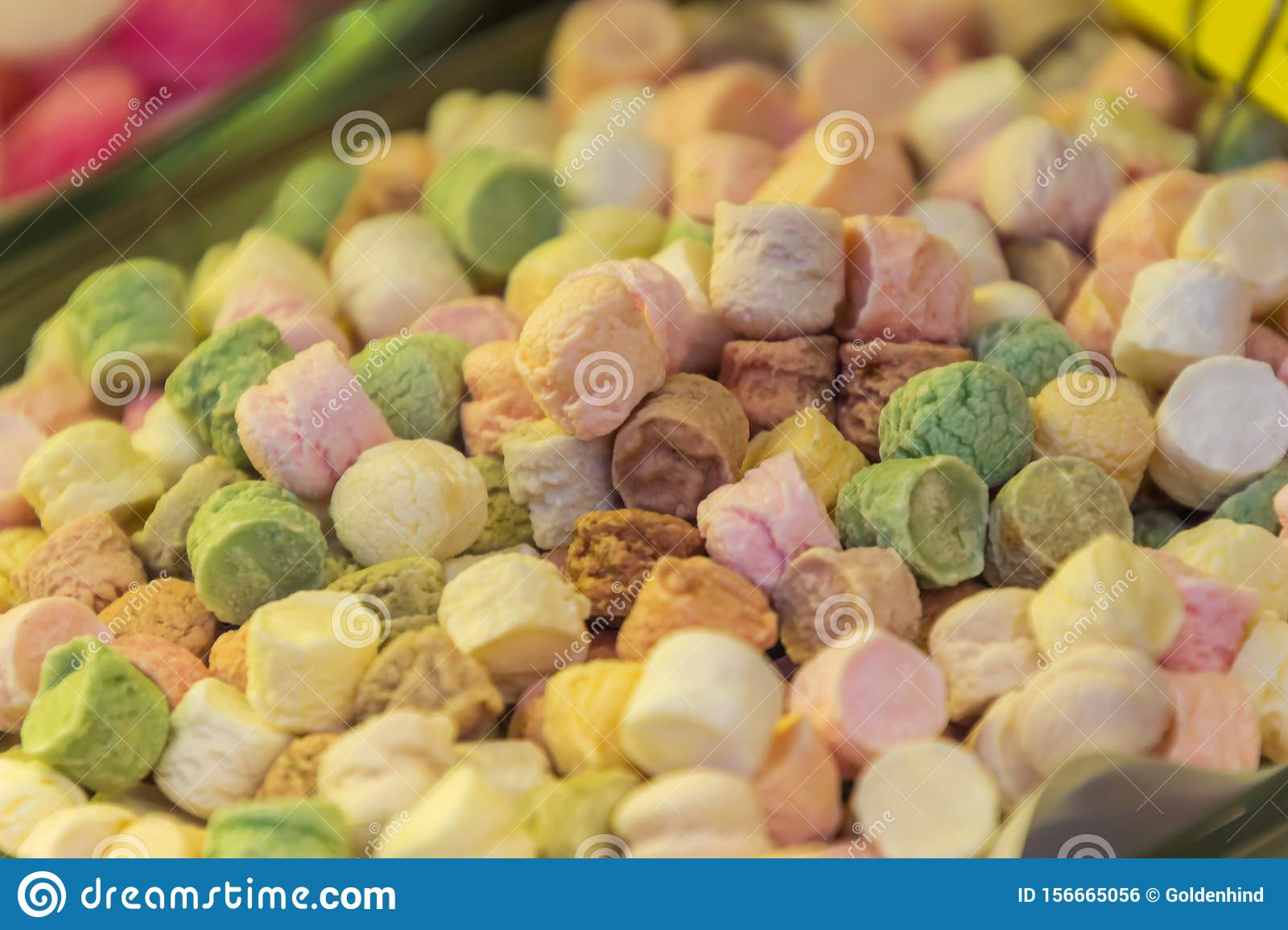 Different colorful round candies in the sweets shop for background