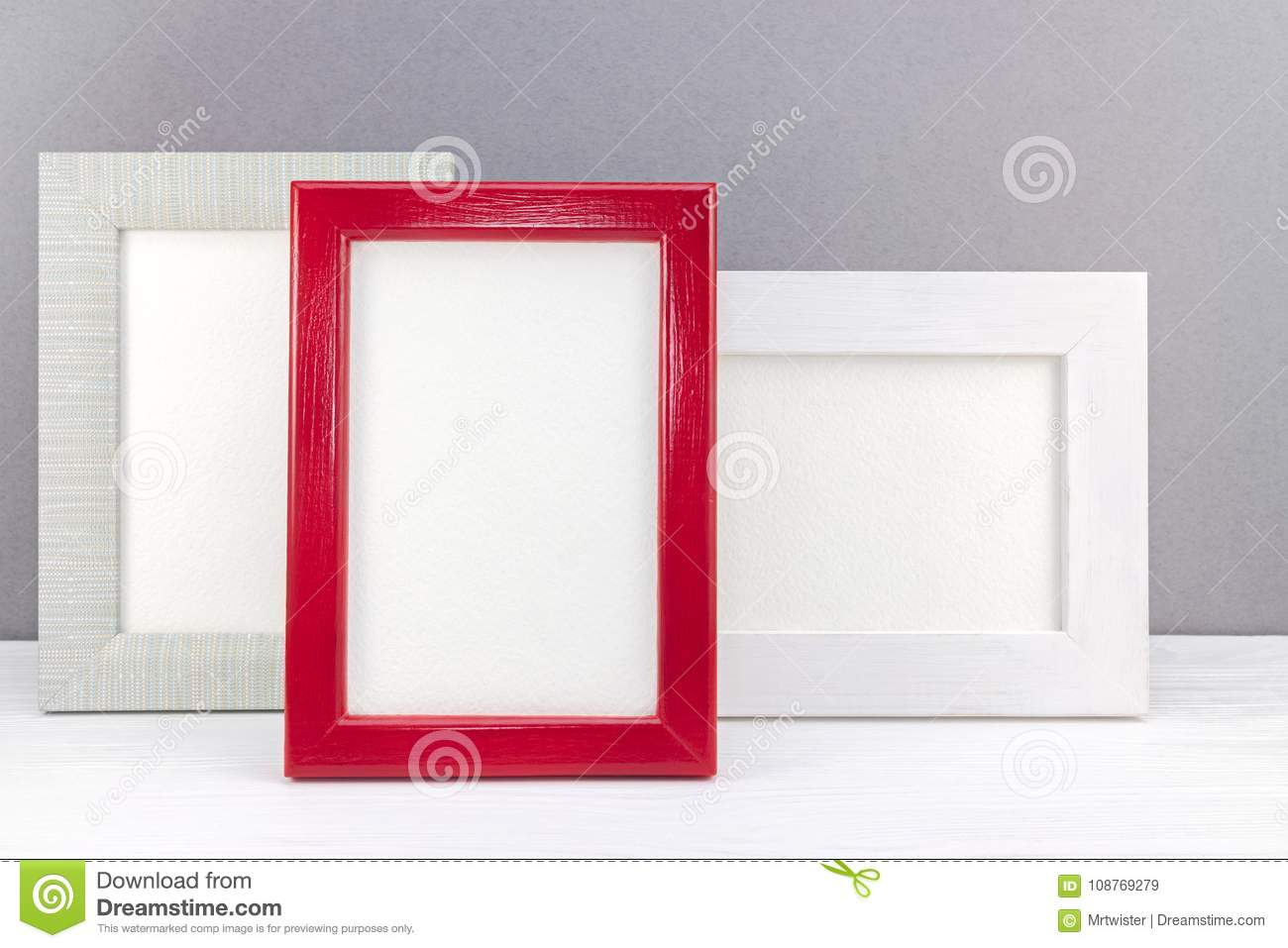 Different Empty Photo Frames On White Wooden Desk Stock Image ...