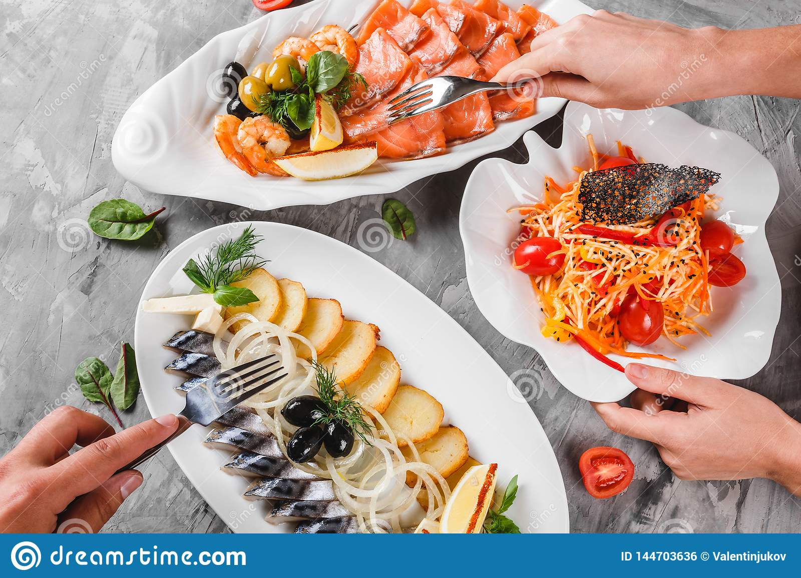 Different Food With Seafood Platter With Smoked Mackerel Slice Fried Potatoes Salmon Slice Shrimp And Vegetable Salad On Table Stock Photo Image Of Healthy Dining 144703636