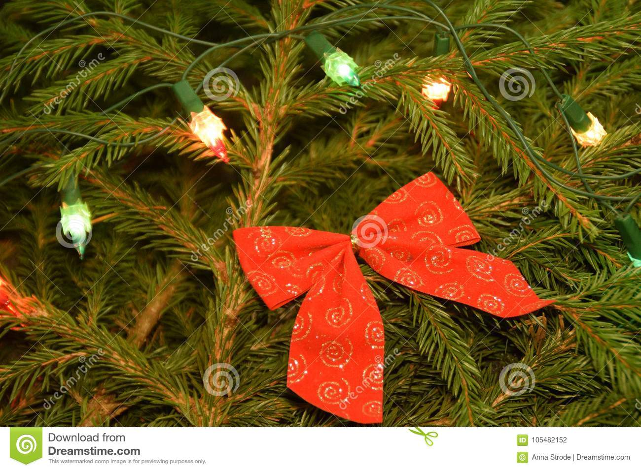 A Different Kind Of Christmas.Christmas Tree Lights And Decorations On Fir Tree Branches