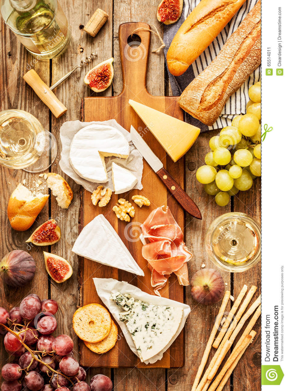 Different Kinds Of Cheeses Wine Baguette Fruits And Snacks Stock