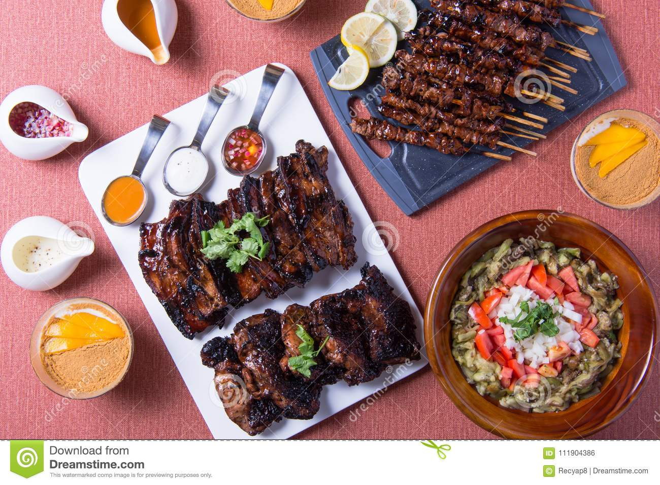 Different kinds of filipino barbecue dishes stock photo image of table set of filipino dishes like pork and chicken barbecue eggplant salad and mango cream graham forumfinder Gallery