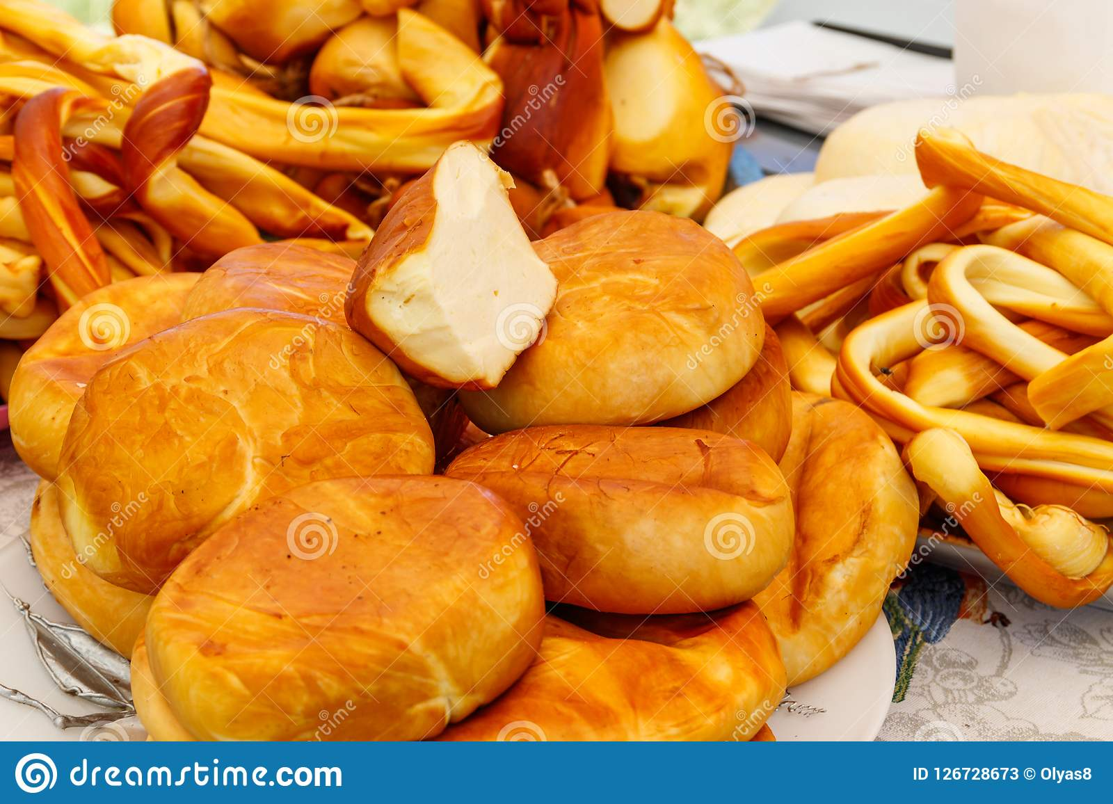 Different kinds of smoked cheese on a table. Different kinds of smoked cheese on the table Stock Photos