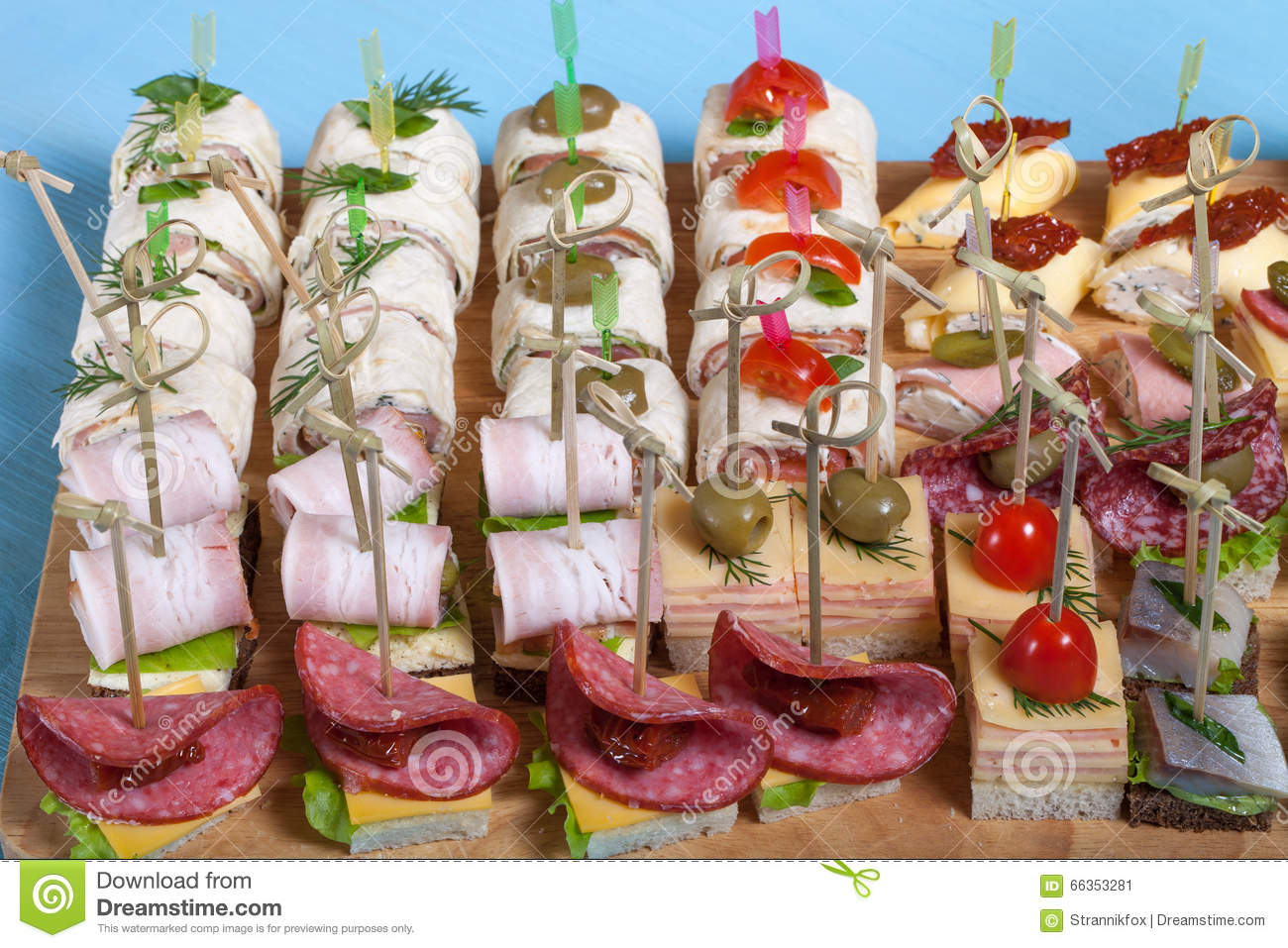 Different kinds of snacks canape on skewers stock image for Canape 4 kinds