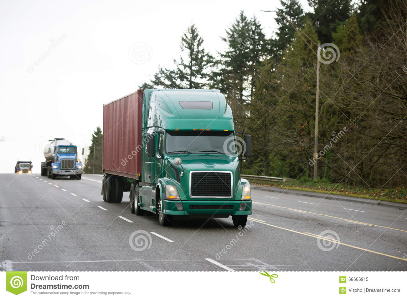 Different models of Semi trucks convoy on wide multiline road