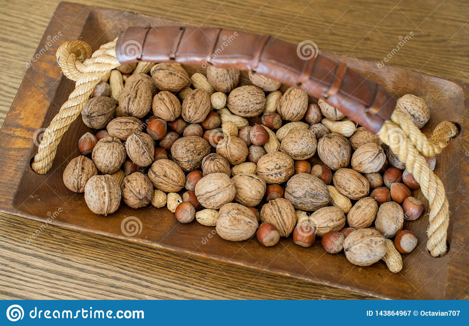 Different nuts in a wooden bowl