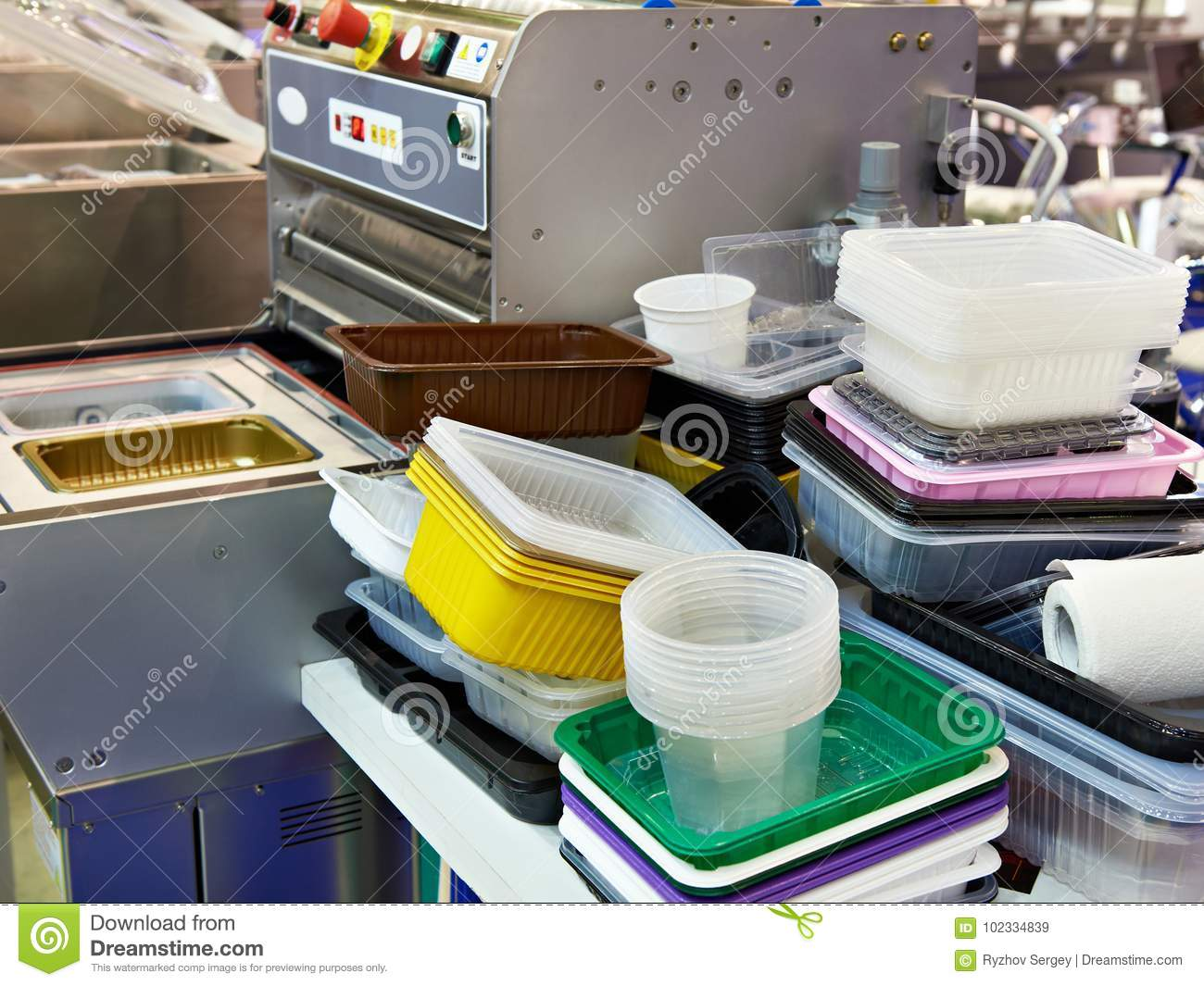 Different plastic containers in food factory