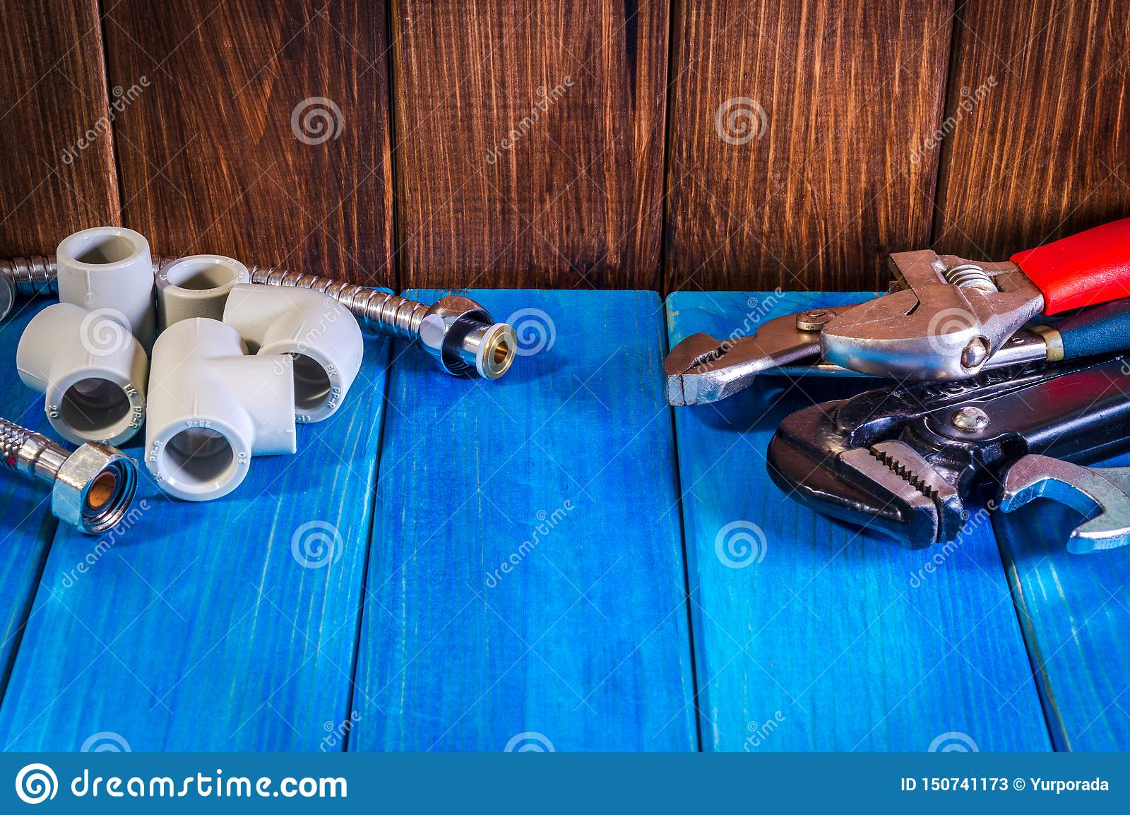 Plumbing Supplies And Tools On A Blue Wooden Background