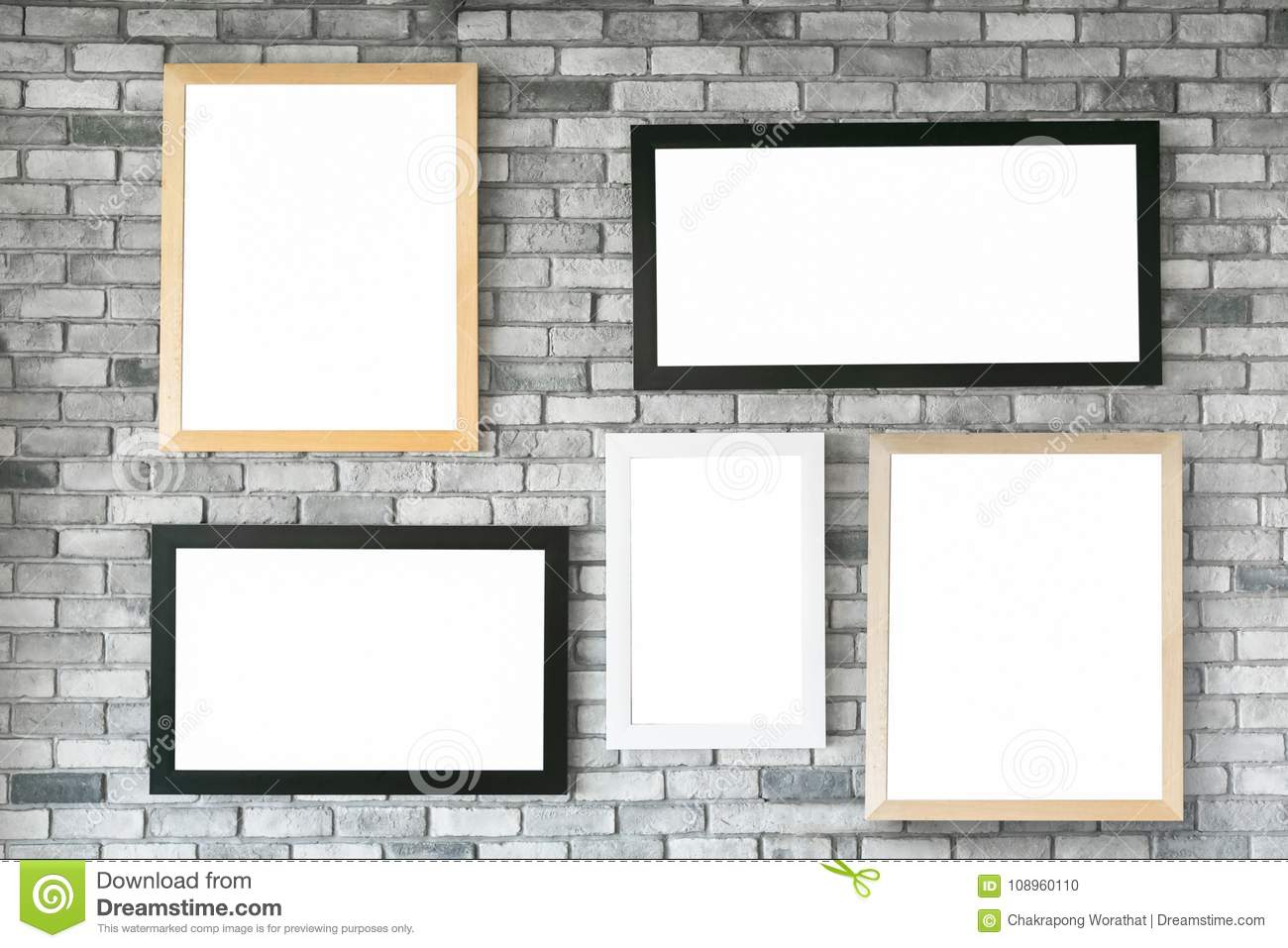 Different Size And Style Empty Photo Frames On White Concrete Wa ...