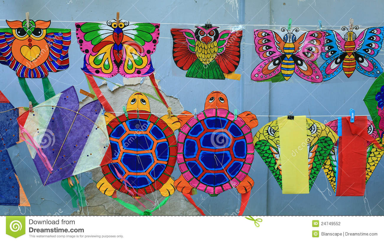Different Styles Of Animal Kites Hanging For Sell Stock
