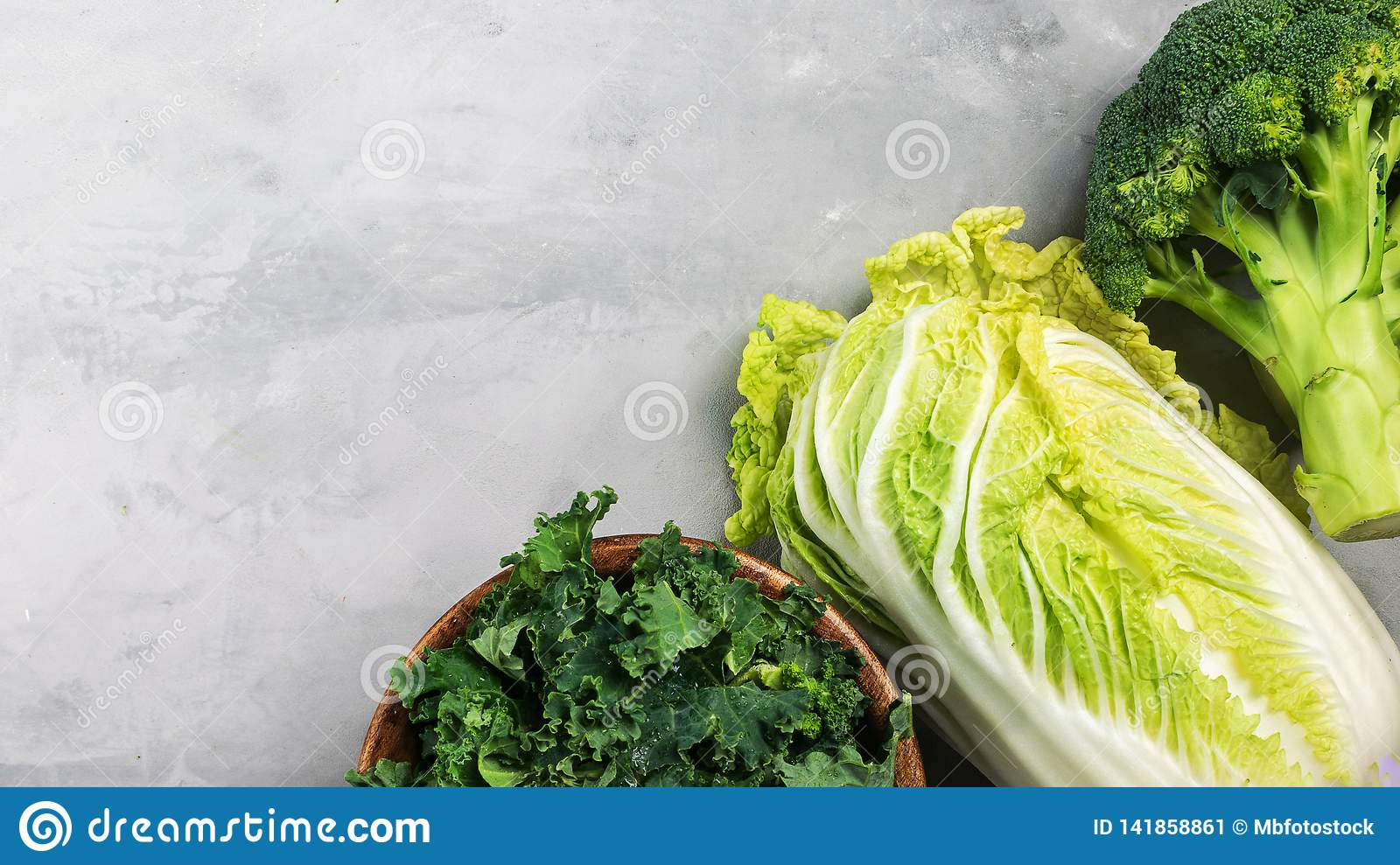 Different types of cabbage. Kale, chinese cabbage, broccoli on a gray background banner. Top view, copy space for text