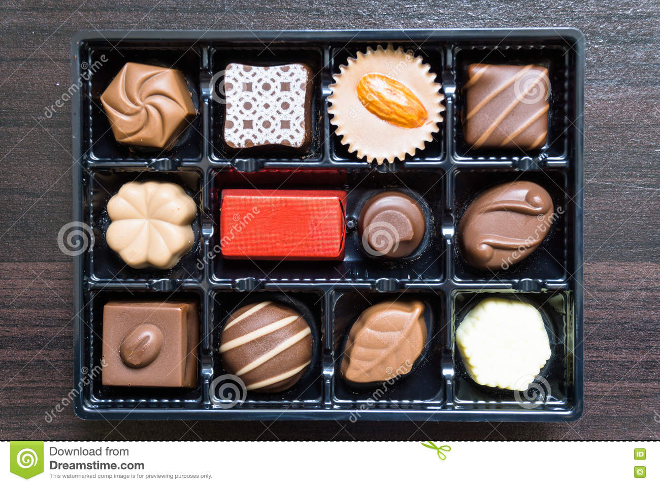 Different Types Of Chocolate Candies On A Wooden Background Stock ...