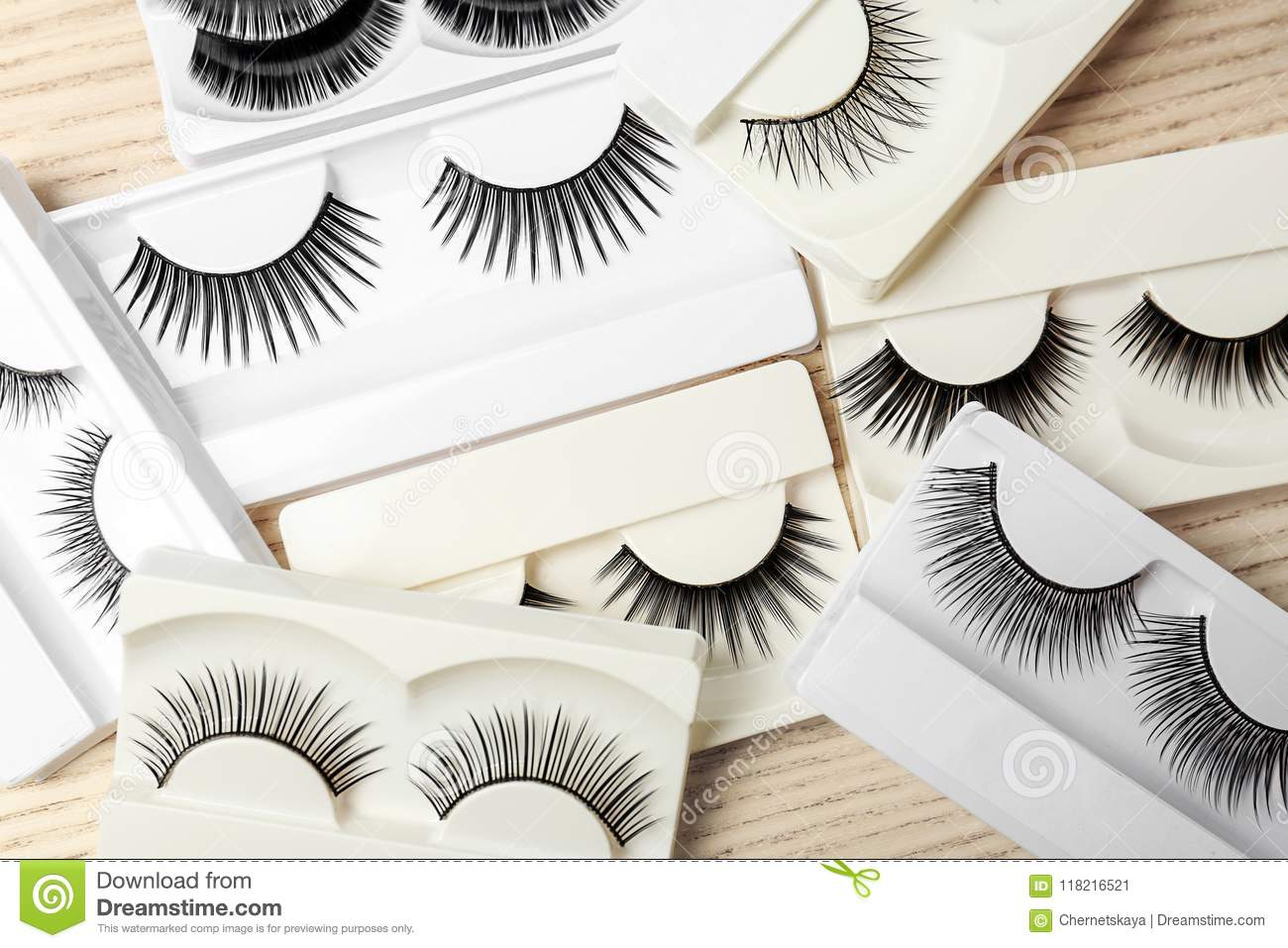 Different Types Of False Eyelashes On Wooden Background Stock Image