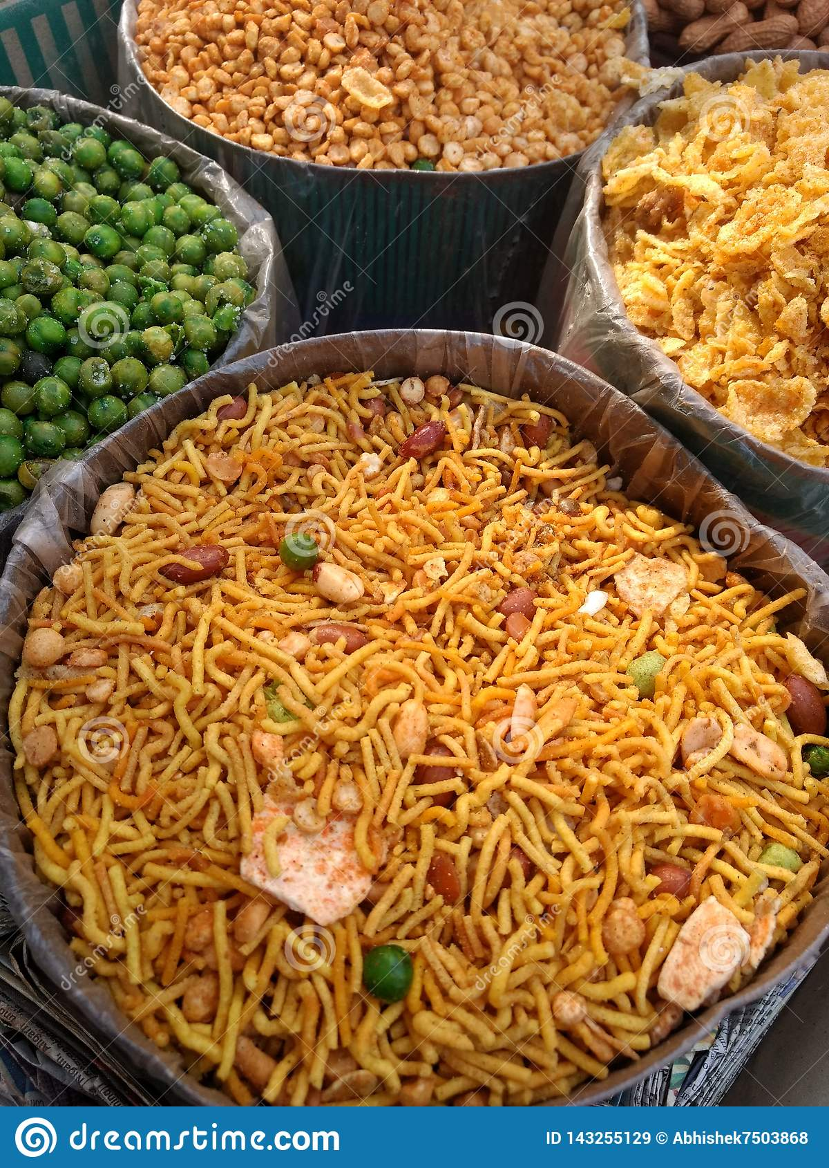 Different types of Indian namkeen and savory snacks selling on the market