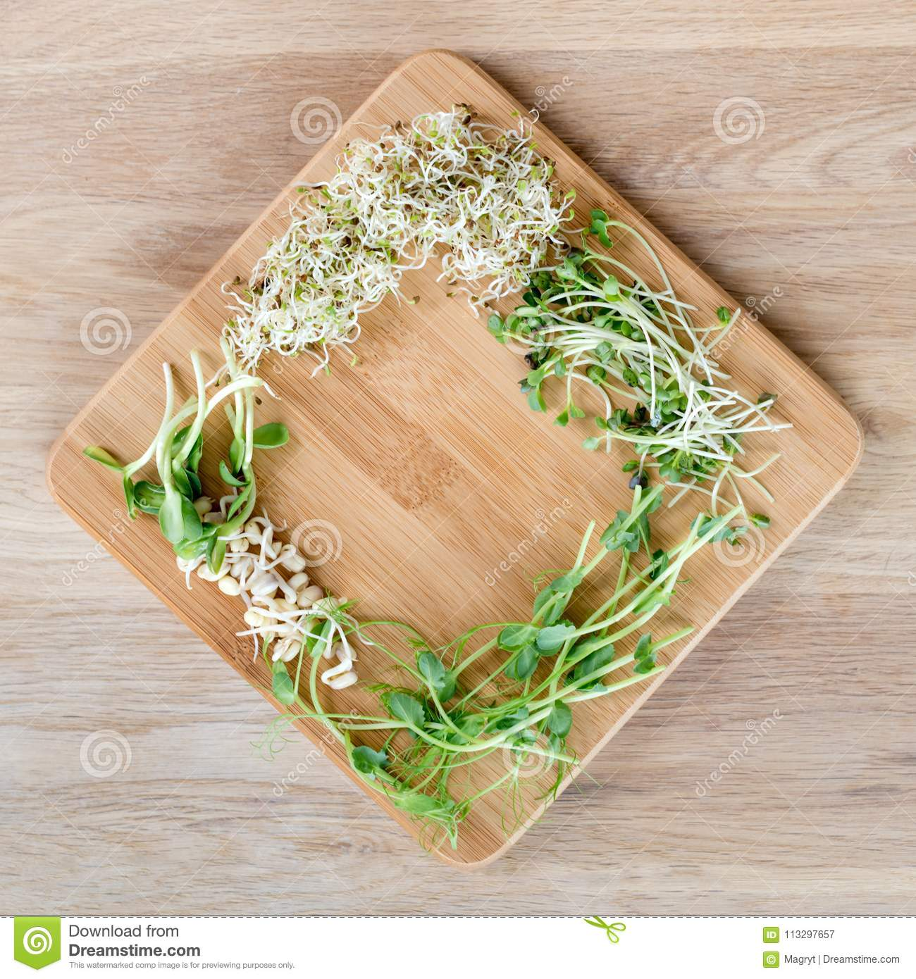 Different Types Of Micro Greens On Wooden Background Fresh Garden