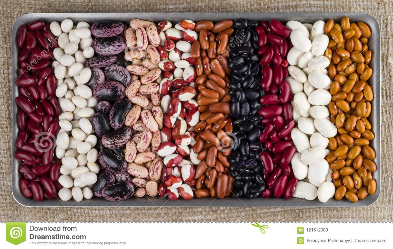 Different varieties of kidney beans against the background of the rough texture of burlap