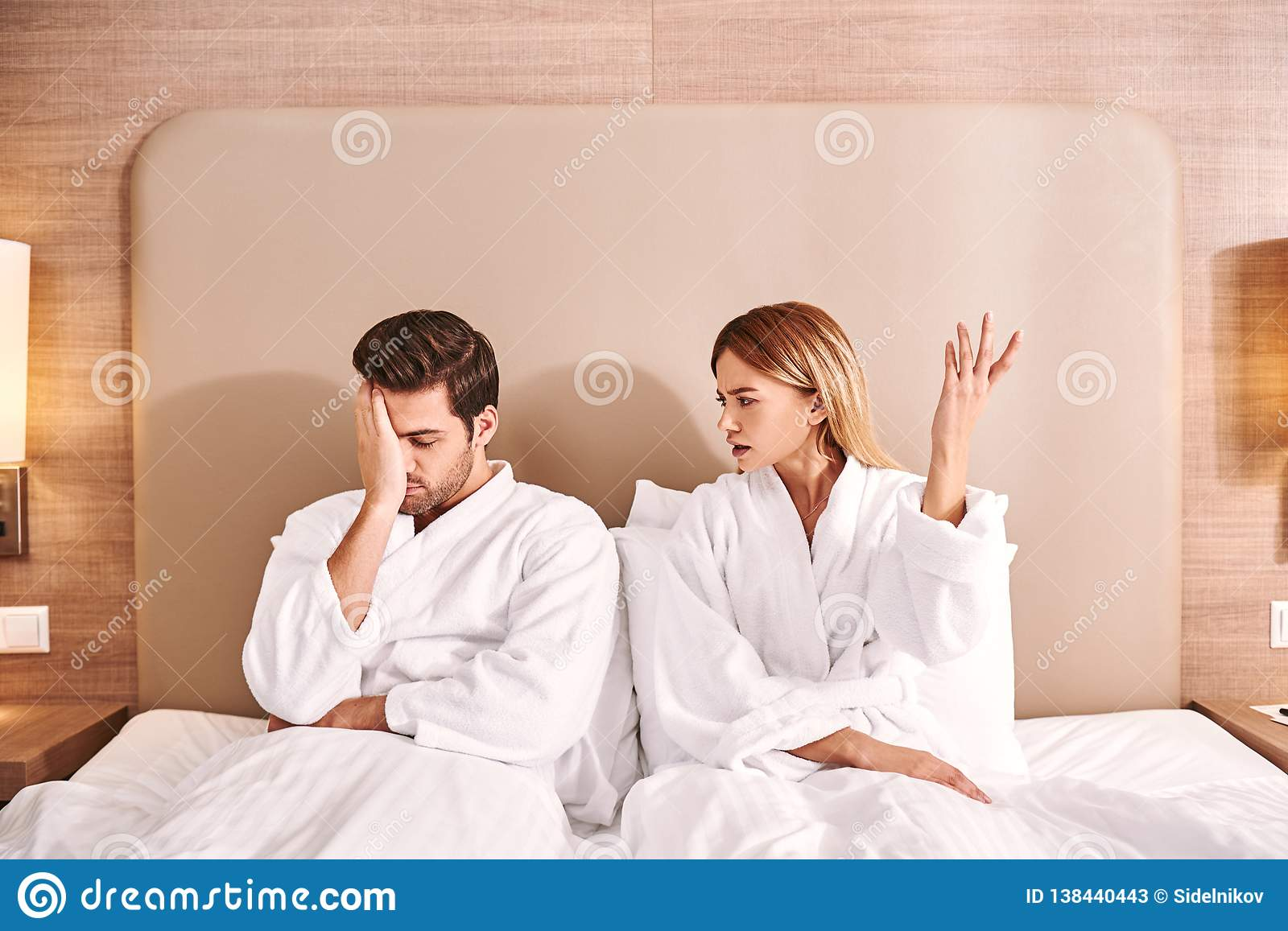 Difficult relationships. Woman have a quarrel with her boyfriend in hotel