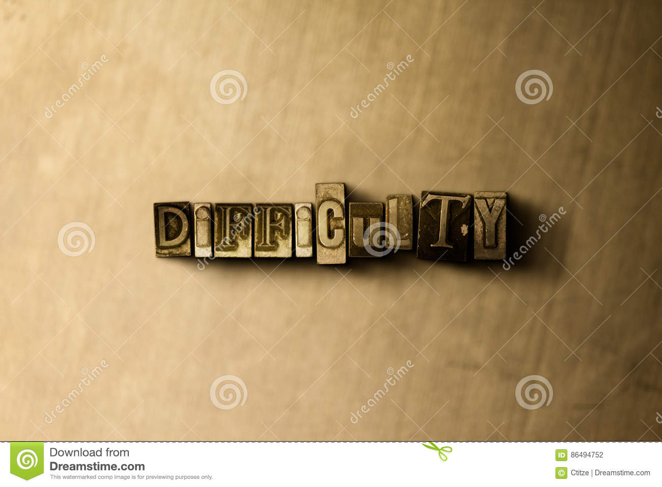 DIFFICULTY - close-up of grungy vintage typeset word on metal backdrop
