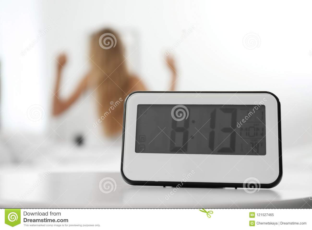 Digital Alarm Clock And Blurred Woman Stock Image - Image of