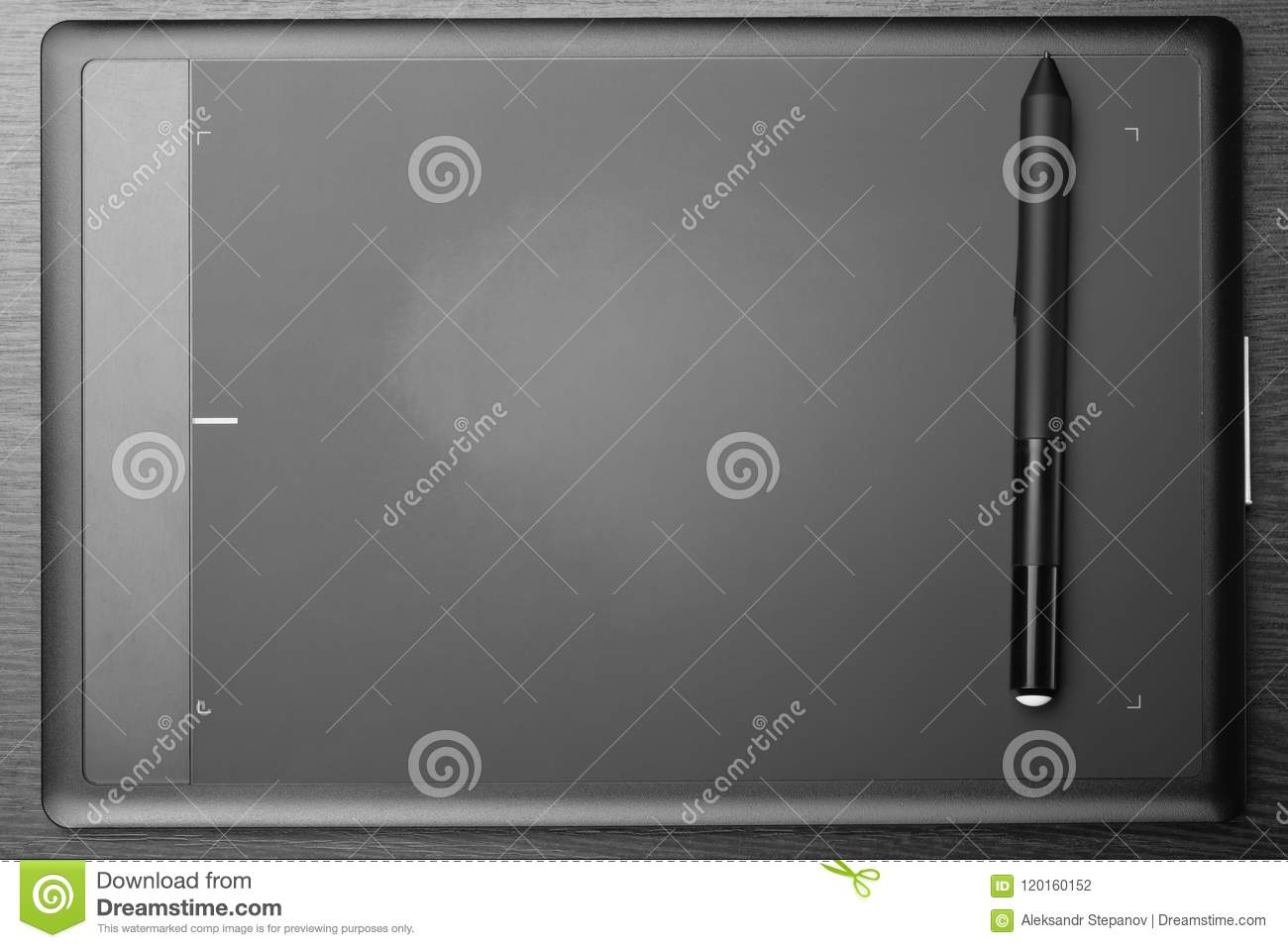 digital art board graphic tablet with stylus on a dark wooden