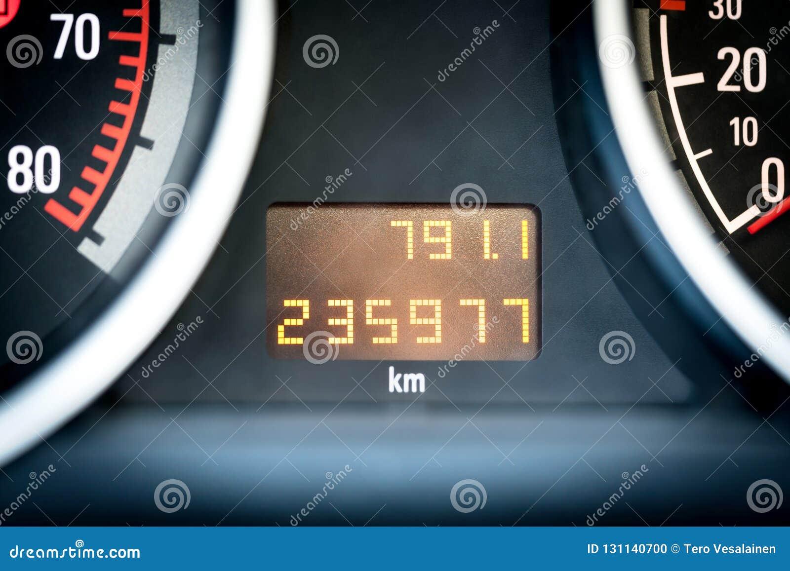 Digital car odometer in dashboard. Used vehicle with mileage meter.