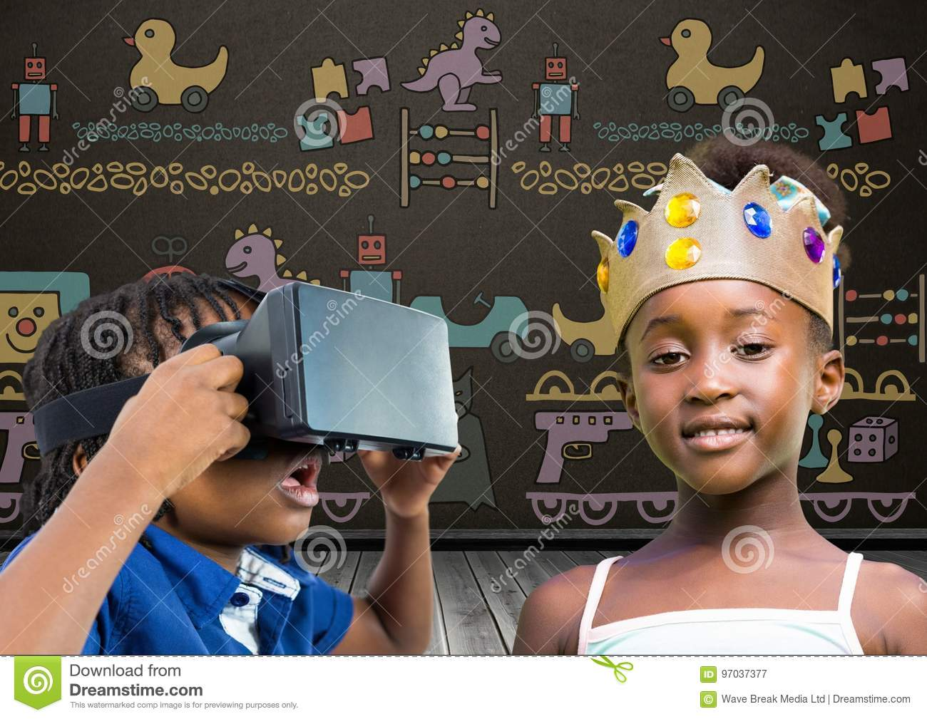 Boy with VR Headset and girl with crown in front of blackboard with toys graphics