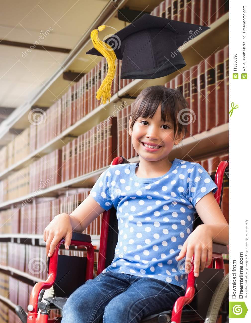 Disabled School girl in education library in wheelchair with graduation hat
