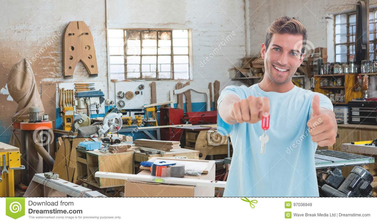 Happy small business owner man holding keys