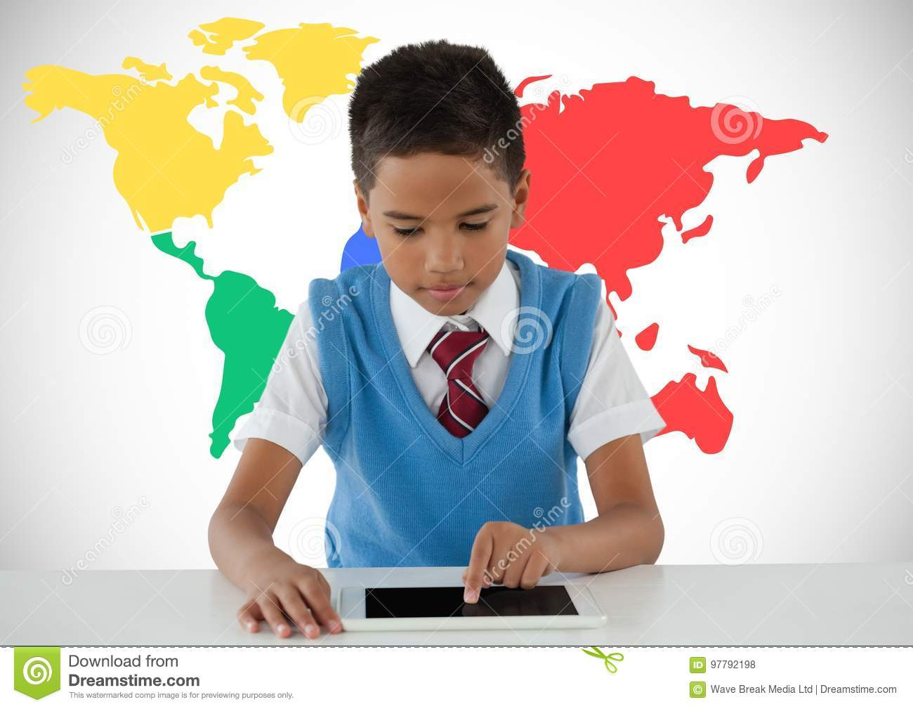 Schoolboy on tablet with colorful world map stock photo image of download comp gumiabroncs Choice Image