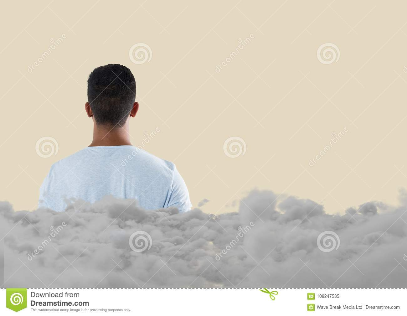 Teenager looking forward with clouds behind him