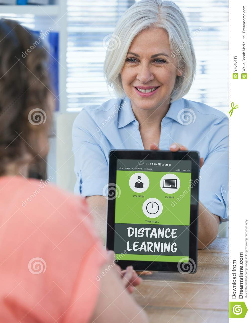 Woman holding a tablet with E-Learning information in the screen