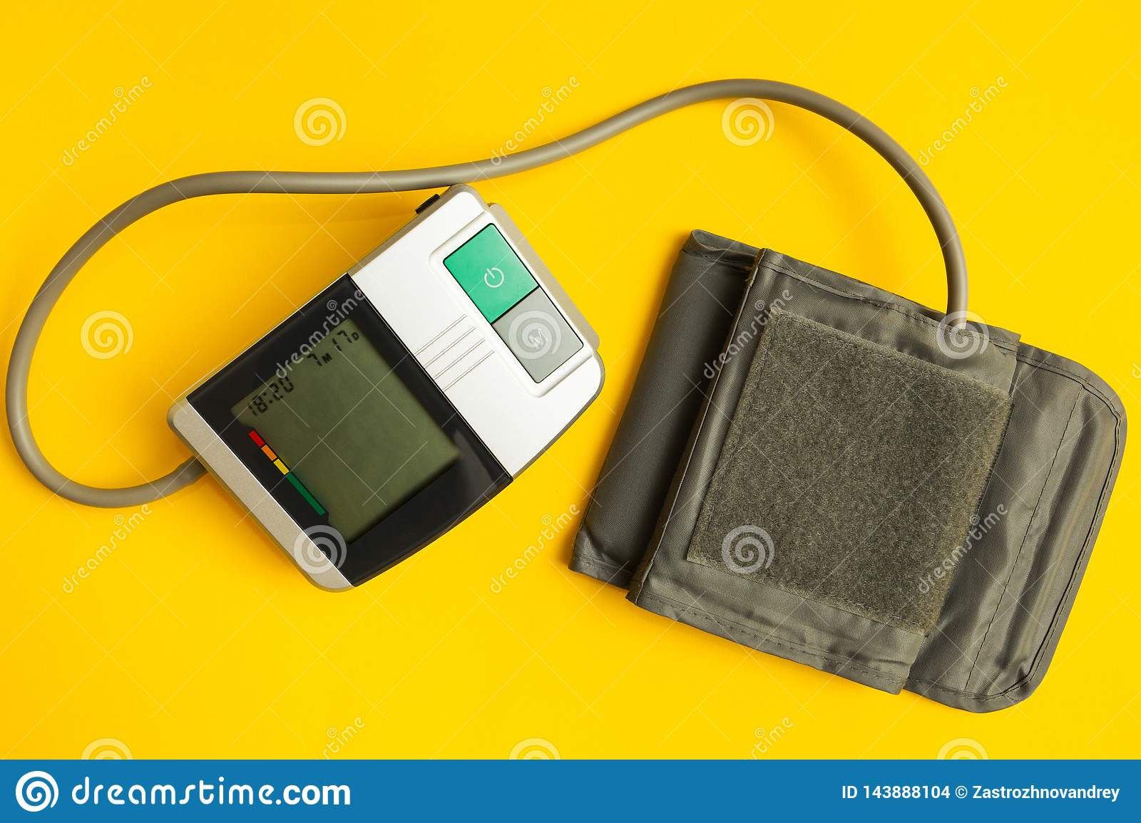 Digital instrument for measuring blood pressure on a yellow background