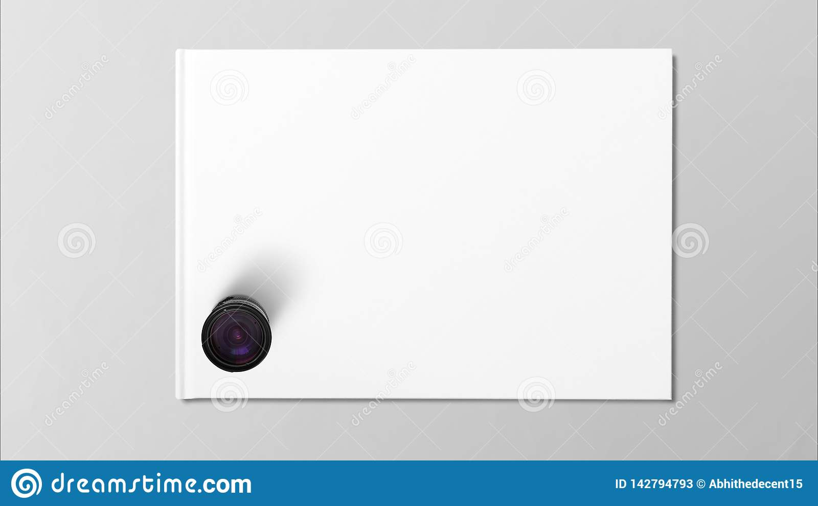Digital lens on white paper on grey background.