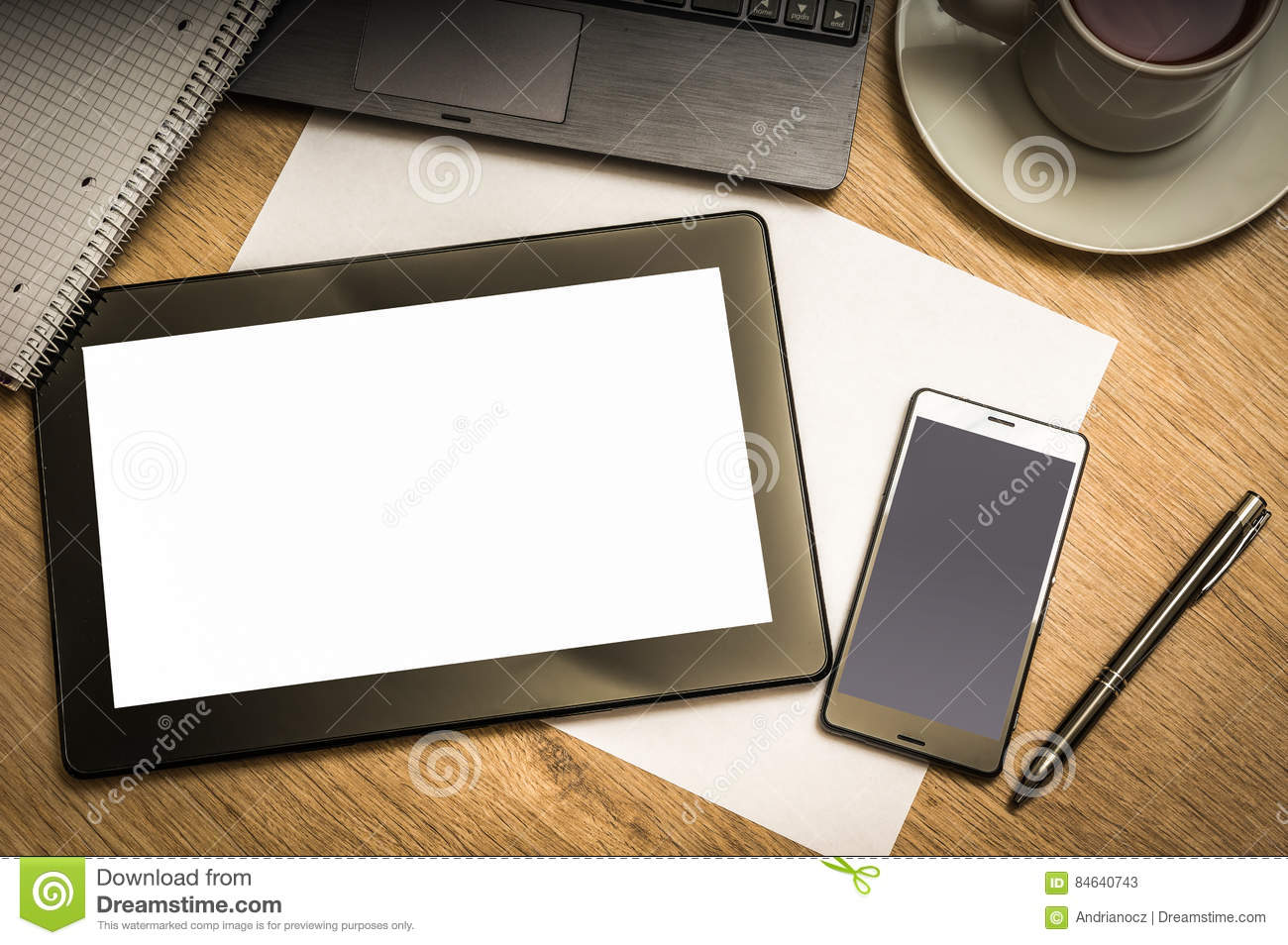 Digital Tablet With Blank Screen On Wooden Table In Office
