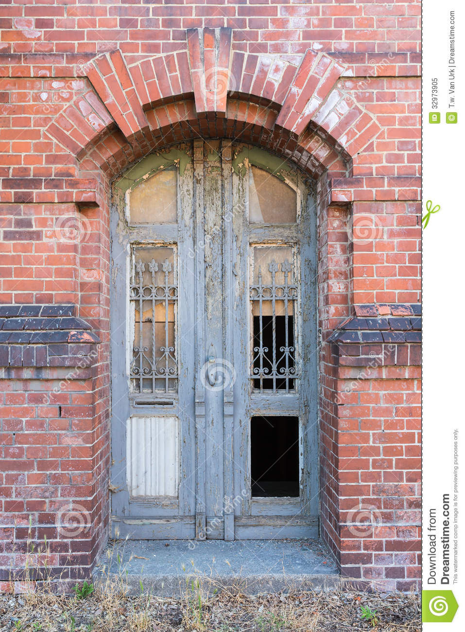 Dilapidated Door In Masonry House Front Royalty Free Stock