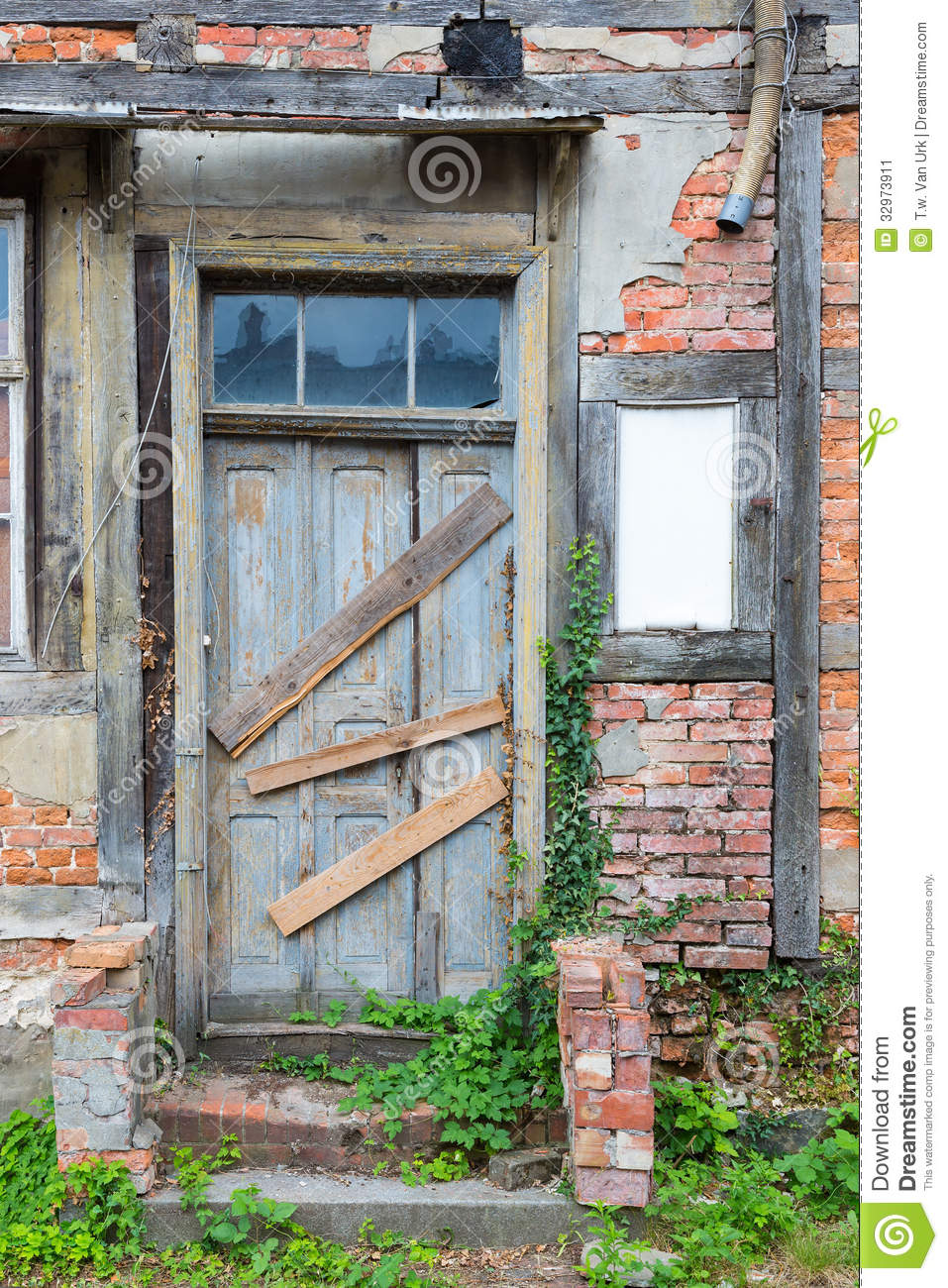 Dilapidated door in masonry house front stock image for Classic house fronts
