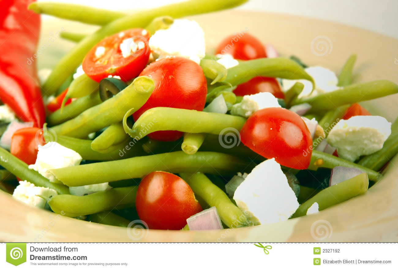 Dilled green beans with cherry tomatoes, feta, olives, and red onions.
