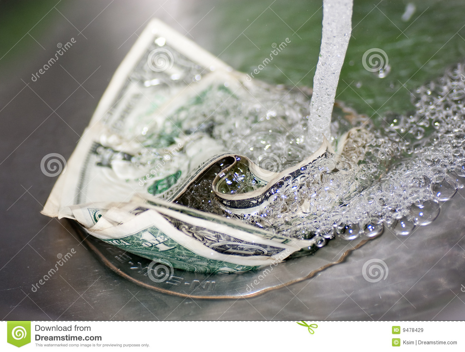Dinero abajo en el dren