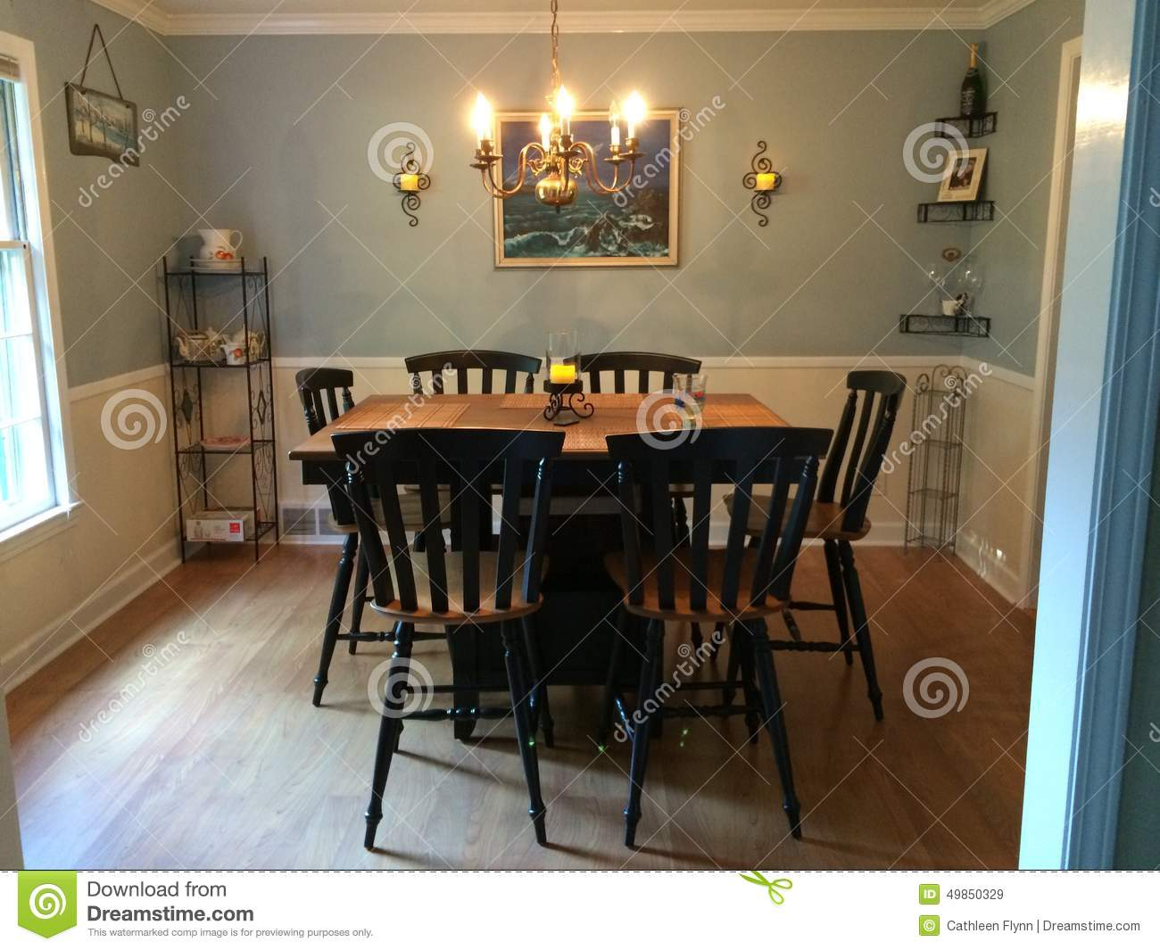 dining room with bar height table and original oil painting bar black chairs dining