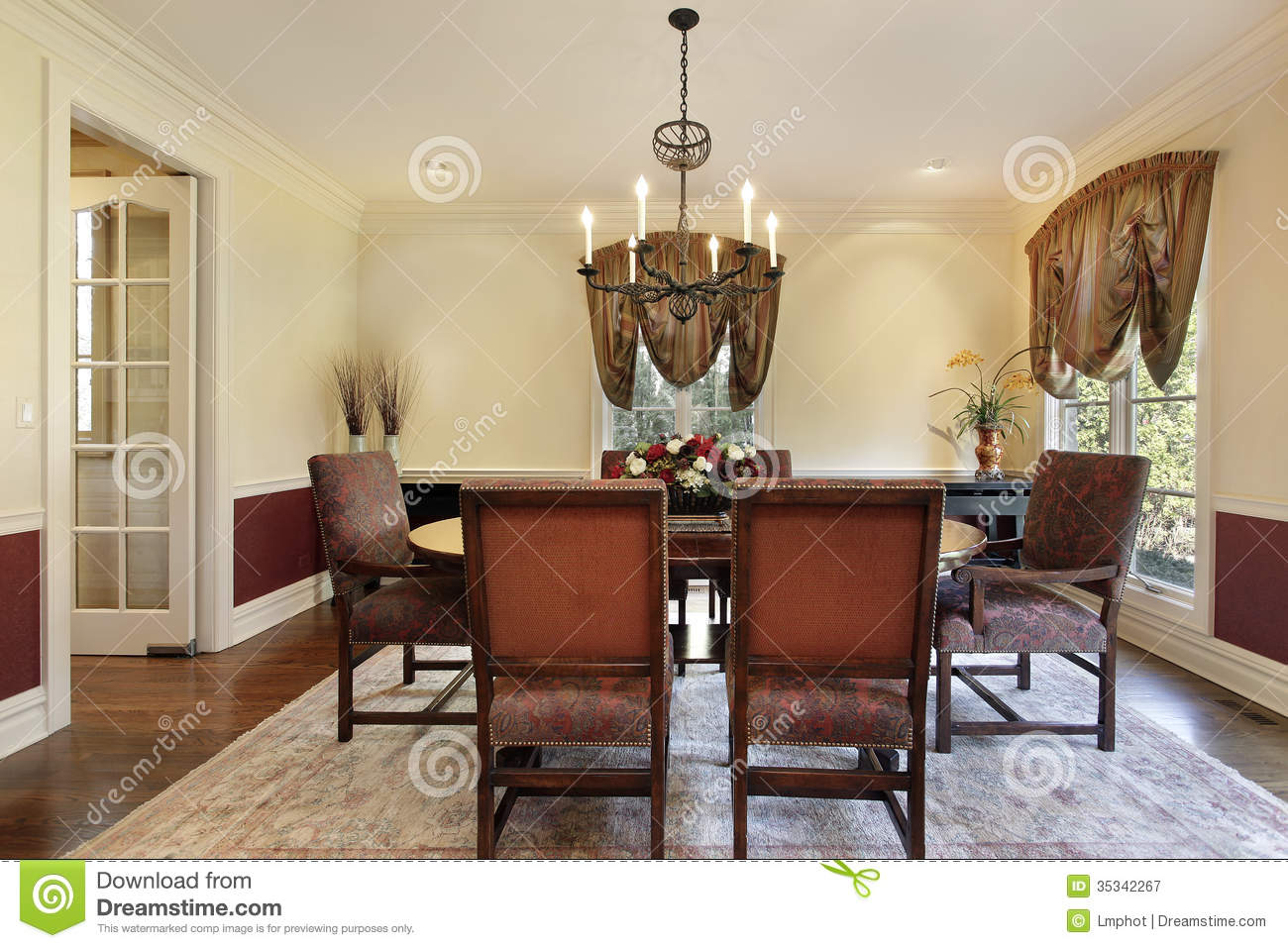dining room with cream colored walls royalty free stock