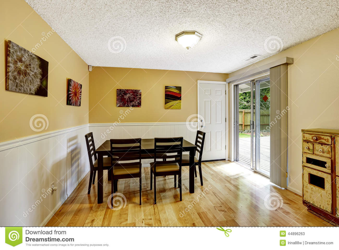 Dining Room With Exit To Backyard Patio Area Stock Photo